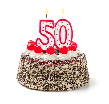 "Birthday cake with ""50"" candle on top"