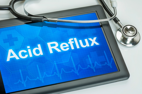 "Computer tablet with the words ""Acid Reflux"" appearing on screen"